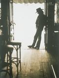 Cowboy Leaning in Doorway Photographic Print by John Halpern