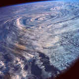 A Satellite View of a Storm Formation over Earth Photographic Print by  Stockbyte
