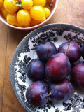 Yellow Cherry Tomatoes and Plums Photographic Print by Laura Johansen