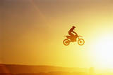 Silhouette of Motocross Race in mid Air, Sunset, Side View Photographic Print by John P Kelly