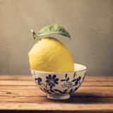 Lemon in Bowl with Flowers Fotografie-Druck von Copyright Anna Nemoy(Xaomena)