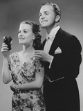 Couple Dressed up Holding Drinks Photographic Print by George Marks