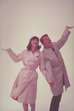 COUPLE IN RAINCOAT WITH HANDS Up, 1962 Photographic Print by Archive Holdings Inc.
