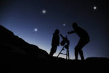 Father and Son Looking through a Telescope at Nigh Photographic Print by Chris Stein