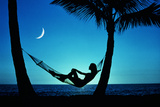 WOMAN IN HAMMOCK BY MOONLIT OCEAN Photographic Print by Kaz Mori