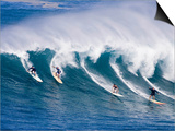 Surfers Ride a Wave at Waimea Beach on the North Shore of Oahu, Hawaii Prints