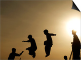 Youths Play on a Trampoline at Sunset in the Neighborhood of Islamabad, Pakistan Posters