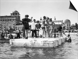 Several Young Men and Women on a Platform in the Water, Some of Them Dancing, on the Lido of Venice Prints