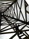 A Reenactor is Silhouetted Inside a Replica of the Spindletop Oil Derrick Prints