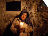 Elderly Woman Holds a Candle as She Takes Part in a Procession During Holy Week in Taxco, Mexico Posters