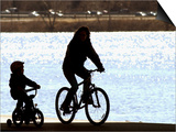 A Mother and Son are Silhouetted as They Ride Along the Schuylkill River Print
