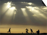 Iraqi Kurdish Boys Play Football as the Sun Sets Poster