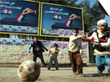 "Iraqi Boys Play Soccer Below the Poster Reading ""To Grant Iraqi Children Better Iraq"" Poster"