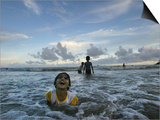Child as She Plays in the Waves at a Beach in Port Blair, India Poster