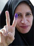 Iraqi Woman Holds Up Her Purple Finger, Indicating She Has Just Voted in Southern Iraq Posters