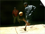 An Egyptian Boy Shows off His Ball Skill as He Plays Soccer with a Friend on the Steets of Cairo Prints