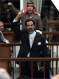Former Iraqi President Saddam Hussein Berates the Court During their Trial in Baghdad Prints