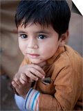Boy Waits to Receive a Ration of Donated Rice at Food Distribution Center in Islamabad, Pakistan Prints