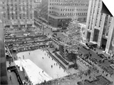 With the Famed Rockefeller Center Christmas Tree Rising Above Them, Skaters Glide on the Ice Prints