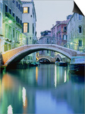 Bridge above a channel in Venice, evening shot Print by Guenter Rossenbach
