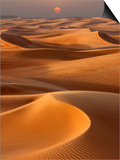 Sunset over the sand dunes in Dubai Poster by Jon Bower