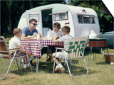 1960s Family Sitting in Lawn Chairs at Picnic Table Beside Camping Trailer Prints