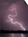 Lightning Striking Ground Near Residential Lake Posters by Jim Reed