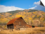 The famous Steamboat Barn, Steamboat Springs Ski Area in the background with yellow aspen trees, Co Posters by Ron Dahlquist