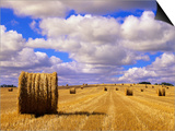 Bales and Clouds Near Sherbrooke, Saskatchewan, Canada. Prints by Mike Grandmaison