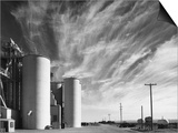 Grain Elevators with Clouds Posters by Gordon Osmundson