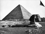 The Sphinx and the Pyramid of Cheops Standing in the Desert Poster