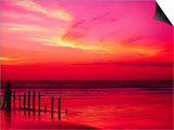 Surf Rolling onto Beach at Sunset Prints by Mick Roessler