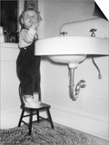 A Young Girl Brushes Her Teeth at the Sink, Ca. 1955 Prints