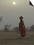 Woman Carrying Water Jar in Sand Storm, Thar Desert, Rajasthan, India Prints by Keren Su