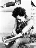 Sid Vicious, of the Punk Group Sex Pistols, Injects Himself with Heroin in 1978 Posters