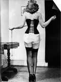 Young Woman Lacing Her Corset Posters by  Bettmann