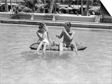 1930s-1940s Couple Drinking While Floating in a Pool on a Rubber Raft at Florida Resort Art