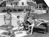 1960s Family in Backyard at Poolside, Father Barbecuing and Mother and Children Making Preparations Prints