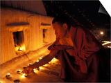 Monk Lighting Butter Lamps at Boudnath, Kathmandu, Nepal Posters by Vassi Koutsaftis