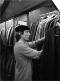 Charlie Watts of Rolling Stones Looks Through a Rack of Suits at Beau Gentry Poster