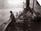 The Crew of a Yarmouth Herring Boat Pull in Their Catch on a Storm Tossed North Sea, 1935 Prints