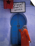 Woman Exits thru Moorish-Style Blue Door, Morocco Prints by John & Lisa Merrill