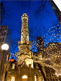 Old Water Tower with holiday lights, Chicago, Illinois, USA Posters by Alan Klehr