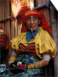 Old Woman with Pipe in Hand-Stitched Molas, Kuna Indian, San Blas Islands, Panama Poster af Cindy Miller Hopkins