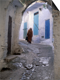 Traditionally Dressed Woman along Cobblestone Alley, Morocco Prints by John & Lisa Merrill