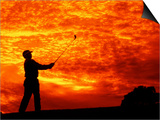Man Swinging Golf Club at Sunset Prints by Bill Bachmann