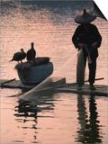 Fisherman Fishing with Cormorants on Bamboo Raft on Li River at Dusk, Yangshuo, Guangxi, China Prints by Keren Su