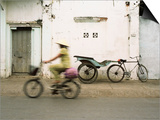 Woman Riding Bicycle Along Street, Ben Tre, Vietnam Prints by Ian Trower
