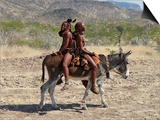 Two Happy Himba Girls Ride a Donkey to Market, Namibia Print by Nigel Pavitt