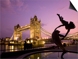 Tower Bridge and Girl with a Dolphin Fountain Statue at Dusk, London, England Posters by Michele Falzone